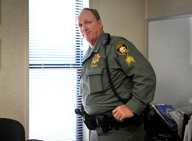 Las Vegas police Sgt. Andy LeGrow admires his view from a window at the Mount Charleston sub station on Tuesday, Aug. 26, 2014. LeGrow leads a team of six officers that patrol the unincorporated a ...