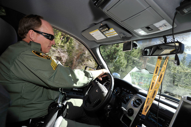 Las Vegas police Sgt. Andy LeGrow patrols in his police vehicle, upper Kyle Canyon Road on Mount Charleston on Tuesday, Aug. 26, 2014. LeGrow leads a team of six officers that patrol the unincorpo ...
