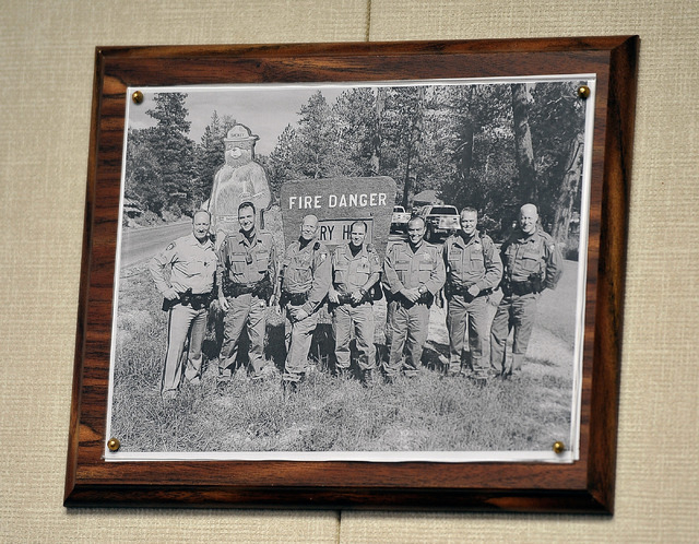 """A group photo of the """"resident"""" officers hangs on the wall at the Las Vegas police's Mount Charleston sub station on Tuesday, Aug. 26, 2014. A team of six officers and a sergeant are ass ..."""