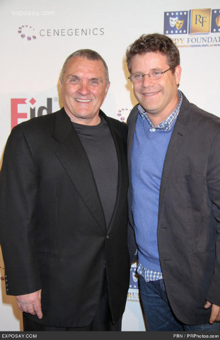 "Rudy Ruettiger and Sean Astin, who portrayed him in the movie, pose on the red carpet for the ""Rudy"" 20th anniversary celebration in Las Vegas. (Courtesy)"