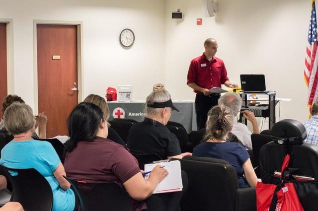 American Red Cross employee Nathaniel Montgomery speaks with residents at a Ready, Set, Respond! workshop Aug. 7 at the Paseo Verde Library, 280 S. Green Valley Parkway. The program aims to teach  ...