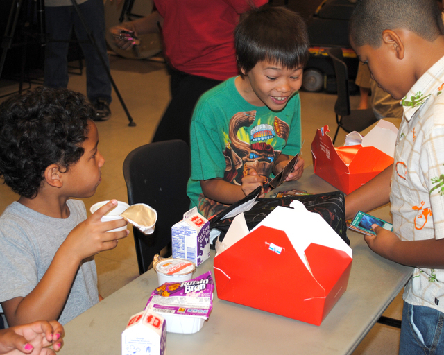 Children play during breakfast at Three Square food bank's Summer Food Service Program site at the Cambridge Recreation Center, 3930 S. Cambridge St. Leaders from Three Square and the U.S. Departm ...