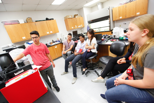 Ian Macato, left, gives a presentation during the Science Summer Camp in the Rod Lee Bigelow Health Sciences building at UNLV on Wednesday, Aug. 6, 2014. The camp, led by Dr. Barbara St. Pierre Sc ...