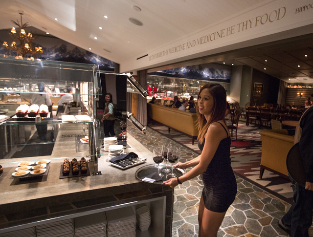 Jackie Lopez serves cocktails at The SLS Buffett during private opening night party  inside  SLS Las Vegas  on Friday Aug. 22, 2014. Lopez, who used to work at Sahara hotel/casino, will be working ...
