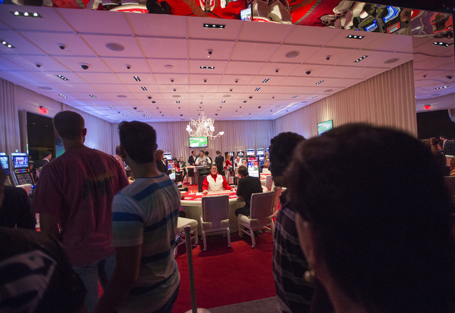 People walk pass the SLS Las Vegas high-limit room on Saturday, Aug. 23, 2014. The $415 million development on the corner of Sahara Avenue and Las Vegas Boulevard South opened at midnight Friday.  ...