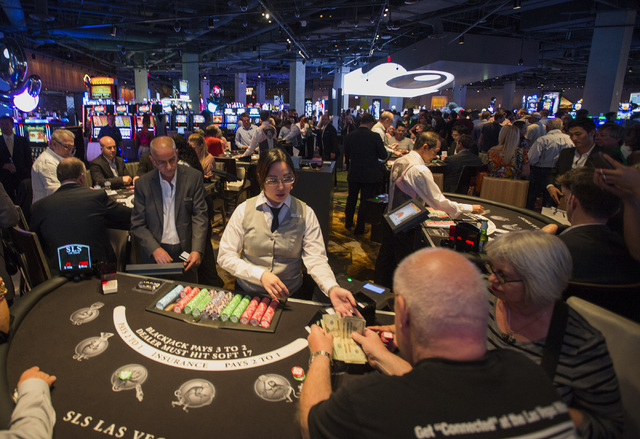 Gamers play table games shortly after midnight at SLS Las Vegas on Saturday, Aug. 23, 2014. The $415 million  development on the corner of Sahara Avenue and Las Vegas Boulevard opened at midnight  ...