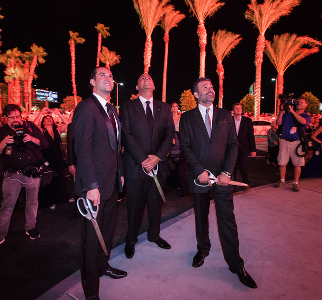 Sam Bakhshandehpour, left, president of SBE, Sam Nazarian, CEO of SBE Entertainment, and Arash Azarbarzin, president of SBE Hotel Group watch fireworks during the opening of  SLS Las Vegas  on Fri ...