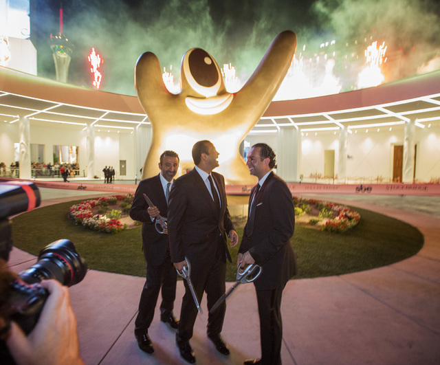 Arash Azarbarzin, left, president of SBE Hotel Group, Sam Nazarian, CEO of SBE Entertainment, Sam Bakhshandehpour, president of SBE,watch fireworks during the opening of  SLS Las Vegas  on Friday  ...