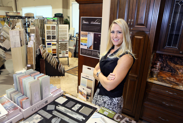 Michelle Roche puts together flooring samples for a client while visiting the showroom at ProSource, Aug. 1. Roche, who is an interior designer and the owner of Parlor 430, won the second season o ...