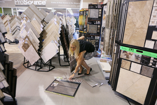 Michelle Roche looks through flooring samples for a client while visiting the showroom at ProSource Friday, Aug. 1, 2014, in Las Vegas. Roche, who is an interior designer and owner of Parlor 430,  ...