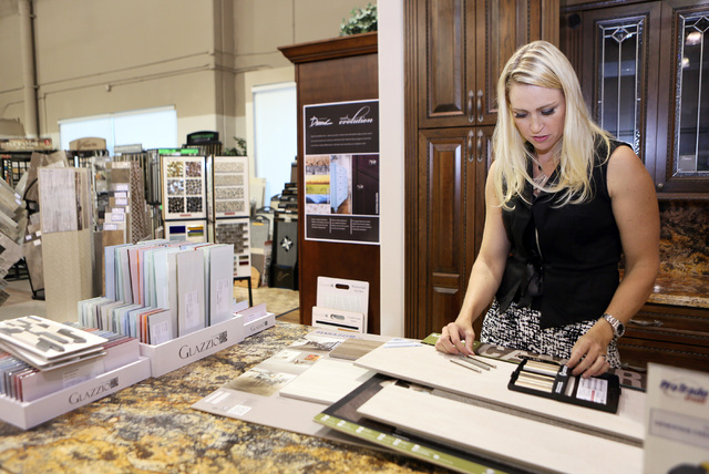 Melissa Roche puts together flooring samples for a client while visiting the showroom at ProSource, Aug. 1. Roche, who is an interior designer and the owner of Parlor 430, won the second season of ...