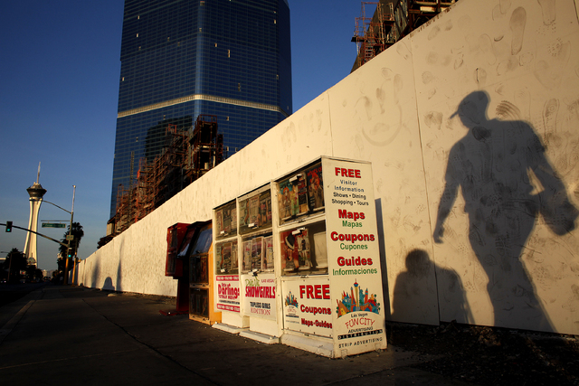 A man walks by news racks along Las Vegas Boulevard in Las Vegas Friday, Feb. 22, 2013. Clark County Manager Don Burnette is recommending to commissioners to prohibit news racks along The Strip. ( ...