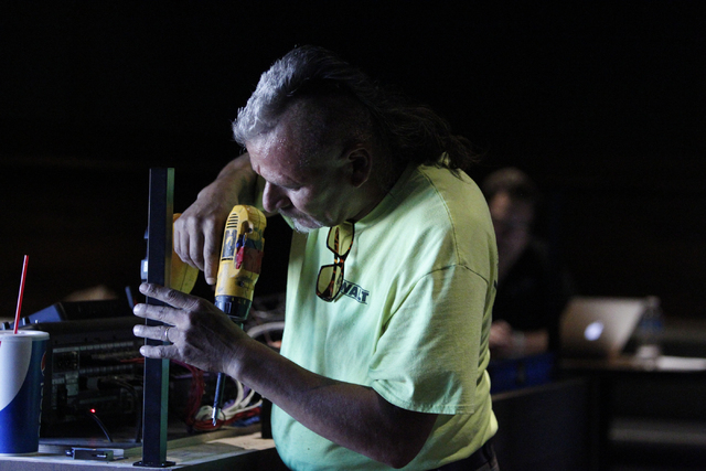 Richard Agado, glazer with Pinnacle Glass & Glazing, installs the disc jockey booth at Bunkhouse Saloon, 124 S. 11th St. in Las Vegas Tuesday, Aug. 19, 2014. The re-opening of Bunkhouse Saloon is  ...