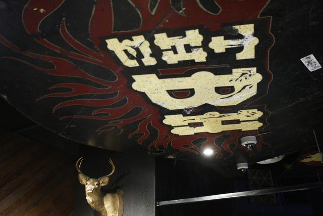 A deer head and pieces of the old stage floor decorate the ceiling above the bar area at the Bunkhouse Saloon, 124 S. 11th St. in Las Vegas Tuesday, Aug. 19, 2014. The re-opening of Bunkhouse Salo ...
