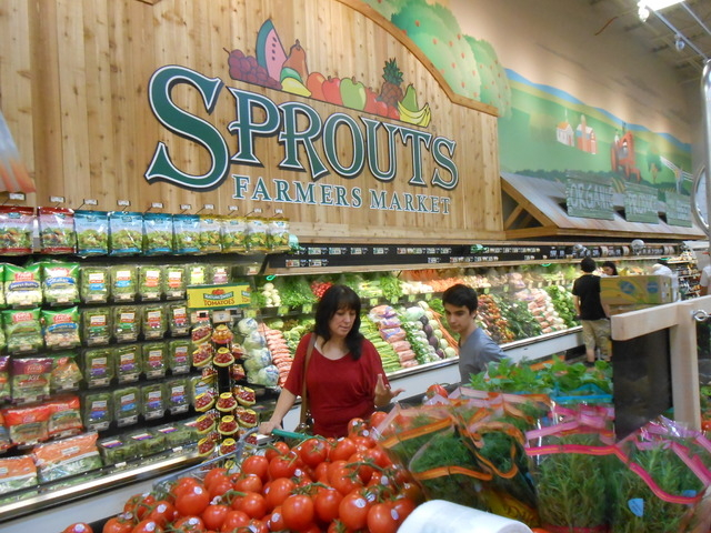 Shoppers look over the produce available at the newly opened Sprouts Farmers Market July 31 on the northeast corner of Sahara Avenue and Hualapai Way. The 28,000-square-foot store is one of the fi ...