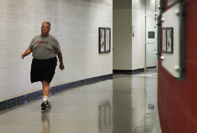 UNLV's Director of Athletic Equipment and Purchasing Paul Pucciarelli gets in his daily exercise walking the hallways of the Lied Athletic Complex in Las Vegas on Friday, Aug. 1, 2014. (Jason Bean ...