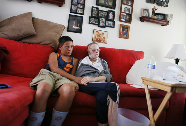 Shirley Andrews, right, sits with her grandson Bryce Avecilla, 13, in the Andrews home Thursday, July 24, 2014, in Las Vegas. After a long search for treatment, the Andrews found local neurosurgeo ...