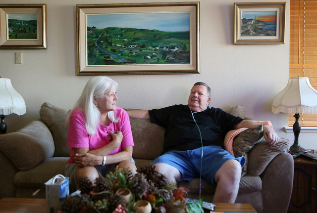 Dennis Glans, right, looks to his wife Joan, who speaks about Dennis during a home interview Thursday, July 24, 2014, in Las Vegas. After a long search for treatment, Dennis found local neurosurge ...