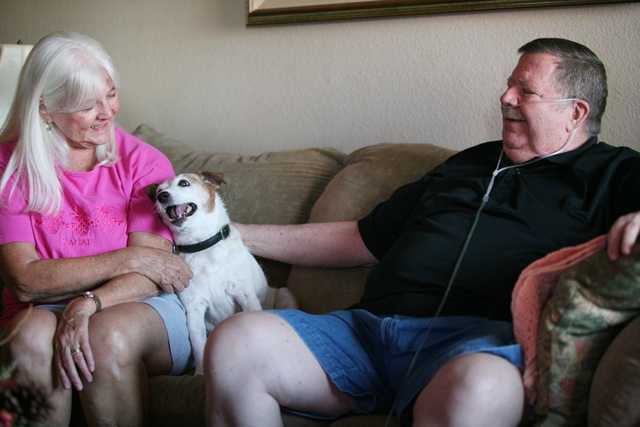 Dennis Glans, right, sits with his wife Joan, and their dog Jessie in their living room during a home interview Thursday, July 24, 2014, in Las Vegas. After a long search for treatment, Dennis fou ...