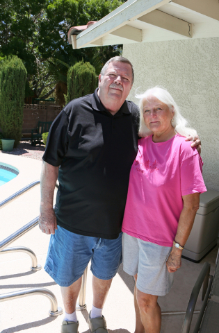 Dennis Glans, left, stands with his wife Joan, in their backyard Thursday, July 24, 2014, in Las Vegas. After a long search for treatment, Dennis found local neurosurgeon Dr. Bohdan Chopko (cq), w ...