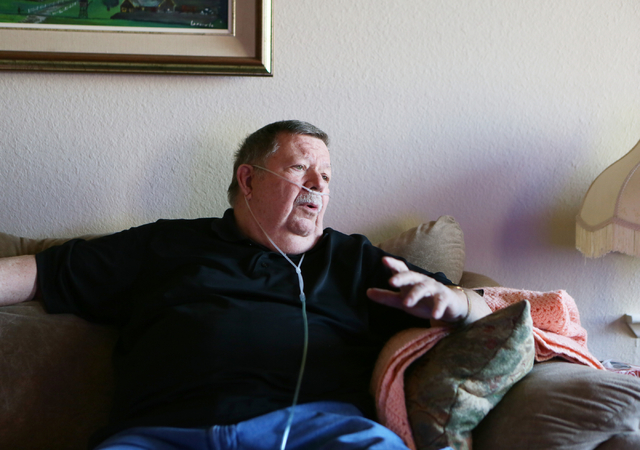 Dennis Glans, participates in a home interview Thursday, July 24, 2014, in Las Vegas. After a long search for treatment, Dennis found local neurosurgeon Dr. Bohdan Chopko (cq), who in May removed  ...