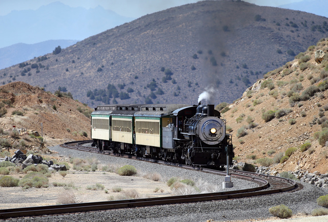The Virginia and Truckee Railroad runs between Carson City and Virginia City, Nev., on Saturday, Aug. 16, 2014. Engine No. 18 is a steam locomotive, a 1918 Baldwin 2-8-2 from the McCloud Railway.  ...