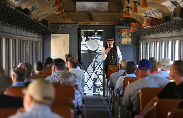 Passengers on the Virginia and Truckee Railroad steam train get a look back in history during their trip from Carson City to Virginia City, Nev., on Saturday, Aug. 16, 2014. (Las Vegas Review-Jour ...