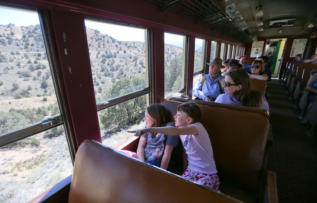 Mackenzie Dean, 7, of Sacramento, left, and Katie Yezek, 8, of Carson City, ride the Virginia and Truckee Railroad steam train with their families from Carson City to Virginia City, Nev., on Satur ...