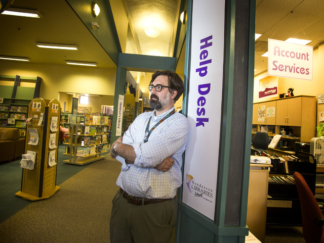 Stephen Platt, branch manager at Green Valley Library, 2797 N. Green Valley Parkway, in Henderson on Tuesday, July 22, 2014. Librarians say the role of libraries is expanding from a quiet reading  ...