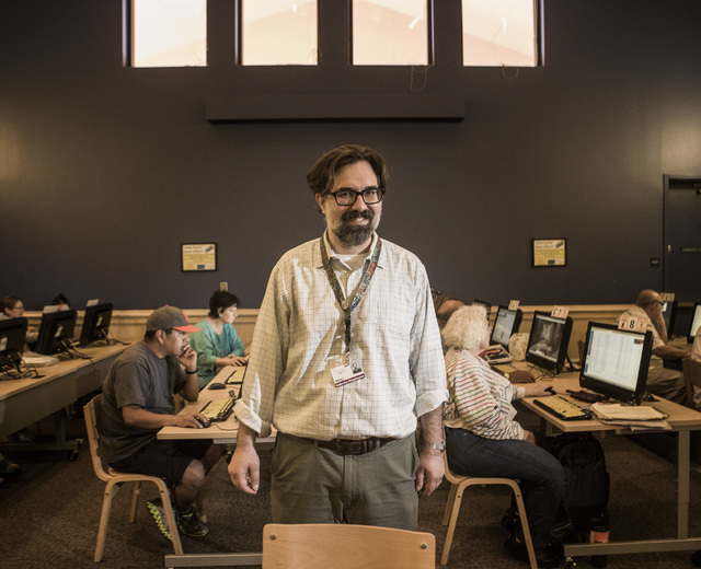 Stephen Platt, branch manager at Green Valley Library, 2797 N. Green Valley Parkway, in Henderson stands in the library's  computer room on Tuesday, July 22, 2014. Librarians say the role of libra ...
