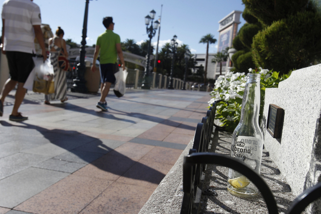 A beer bottle sits on a ledge in front of The Venetian casino-hotel in Las Vegas Tuesday, Aug. 26, 2014. Clark County officials are considering a ban of glass bottles on the Strip. (Erik Verduzco/ ...