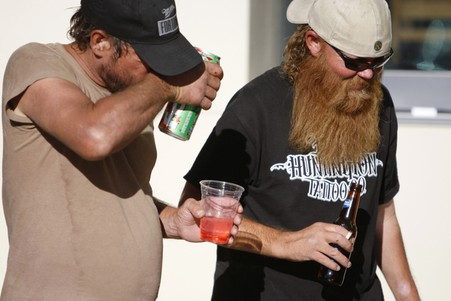 Two men walk near The Linq in Las Vegas holding their drinks Tuesday, Aug. 26, 2014. Clark County officials are considering a ban of glass bottles on the Strip. (Erik Verduzco/Las Vegas Review-Jou ...