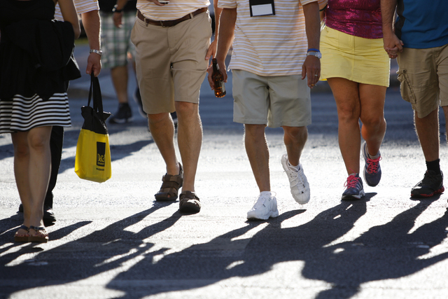 A group of people cross the street near Caesars Palace casino-hotel in Las Vegas Tuesday, Aug. 26, 2014. Clark County officials are considering a ban of glass bottles on the Strip. (Erik Verduzco/ ...