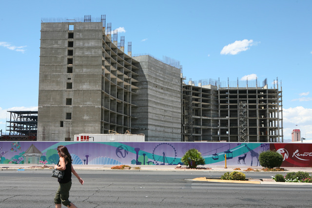A pedestrian walks near the former Echelon project near the Riviera hotel-casino Wednesday, Aug. 20, 2014, in Las Vegas. Plans are underway to transform the site into the Resorts World Las Vegas b ...