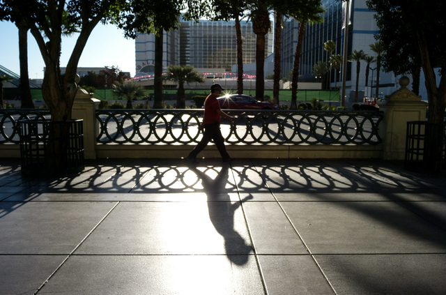 A man walks along the Strip near the Bellagio in Las Vegas on Wednesday morning, Aug. 27, 2014. (Chase Stevens/Las Vegas Review-Journal)