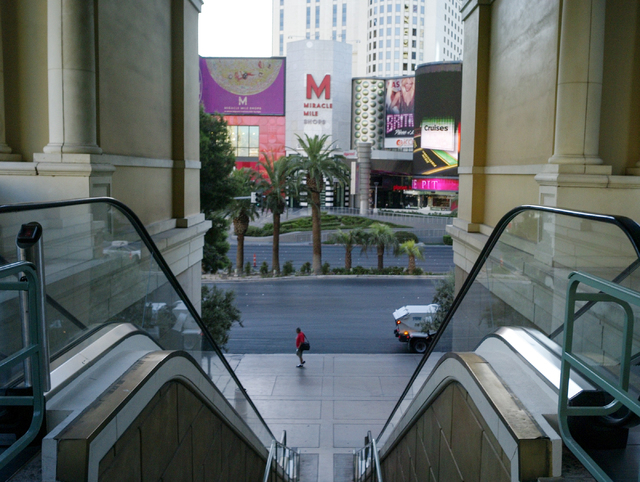 A man walks along the Strip near the Bellagio and Miracle Mile shops in Las Vegas on Wednesday morning, Aug. 27, 2014. (Chase Stevens/Las Vegas Review-Journal)