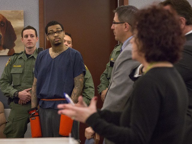 Self-proclaimed pimp and accused killer Ammar Harris listens while prosecutor Lisa Luzaich,right, speaks during sentencing in Clark County District Court on Wednesday, Feb. 26, 2014. District Judg ...