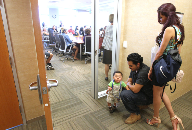 Victor Buendia, Fernanda Salas and their 10-month-old son, Liam Buendia, attend a Southern Nevada Teen Pregnancy Prevention Coalition forum at North Las Vegas City Hall Thursday, Aug. 7, 2014. (K. ...