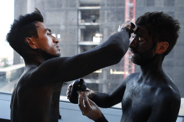 """Brian """"Taxiplasm"""" Gonzalez, left, and Renzo Vitale, paint each other's faces prior to their performance """"Tell Me Your Secrets"""" at P3 Studio at The Cosmopolitan of Las Vegas on Saturday, Aug. 16, 2 ..."""