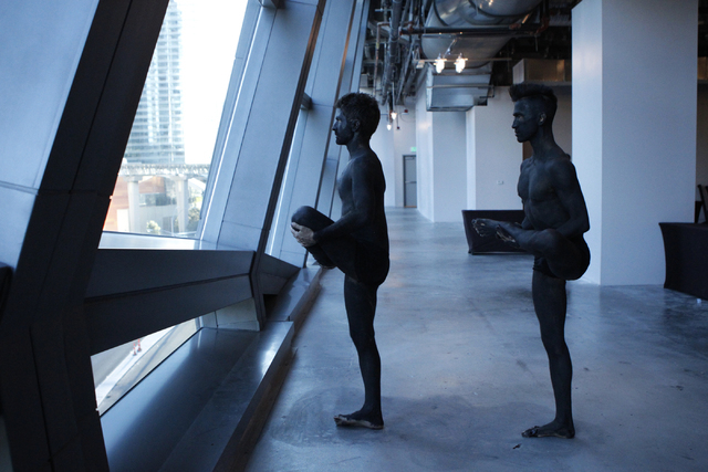 """Performers Renzo Vitale, left, and Brian """"Taxiplasm"""" Gonzalez stretch prior to their performance of """"Tell Me Your Secrets"""" at P3 Studio at The Cosmopolitan of Las Vegas on Saturday, Aug. 16, 2014. ..."""
