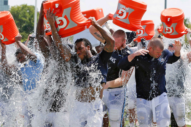 Tennessee Titans players taking part in the ALS Ice Bucket Challenge after NFL football practice in Nashville, Tenn., Aug. 20, 2014. Former Titans linebacker Tim Shaw has announced that he has ALS ...
