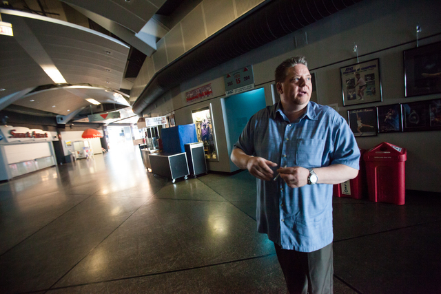 Thomas & Mack Center Executive Director Mike Newcomb talks about slated renovations for the arena while walking through the concourse, in Las Vegas on Wednesday, Jan. 29, 2014. State lawmakers hav ...