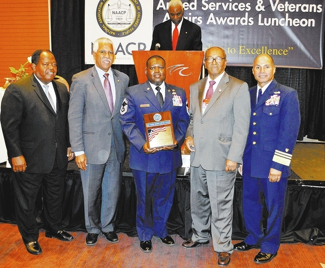Senior Master Sgt. Torry Thompson, center, receives the Roy Wilkins Renown Service Award from NAACP officials during the NAACP's 39th annual Armed Services and Veterans Affairs Awards Luncheon i ...