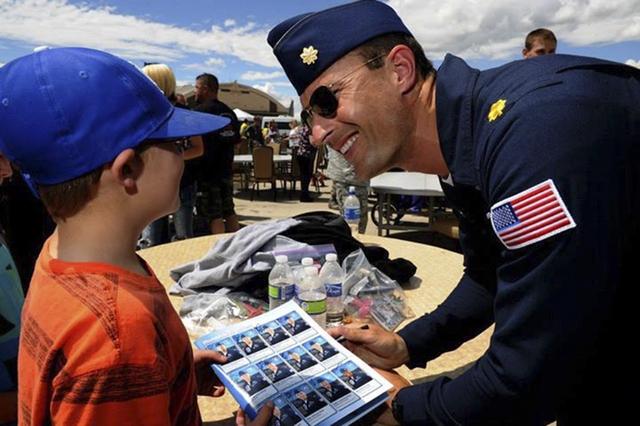Maj. Tyler Ellison, Thunderbird 7, operations officer, interacts with a young fan from the Make A Wish Foundation, during a meet and greet session at Hill Air Force Base, Utah, June 27, 2014.(U.S. ...