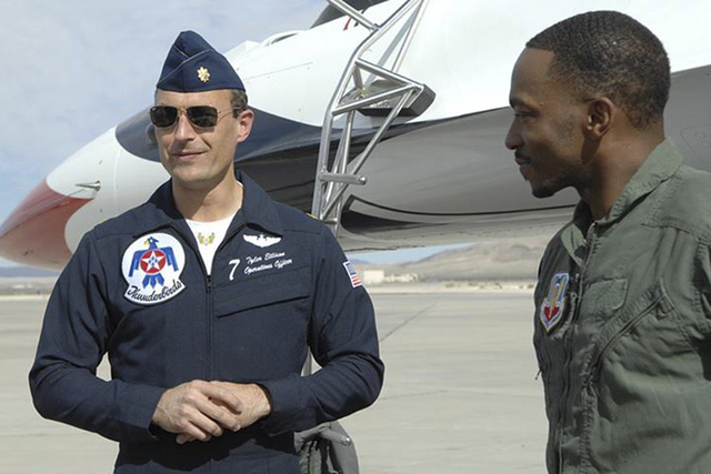 Maj. Tyler Ellison speaks with actor Anthony Mackie after an orientation flight at Nellis Air Force Base in March 2013. (Special to View)