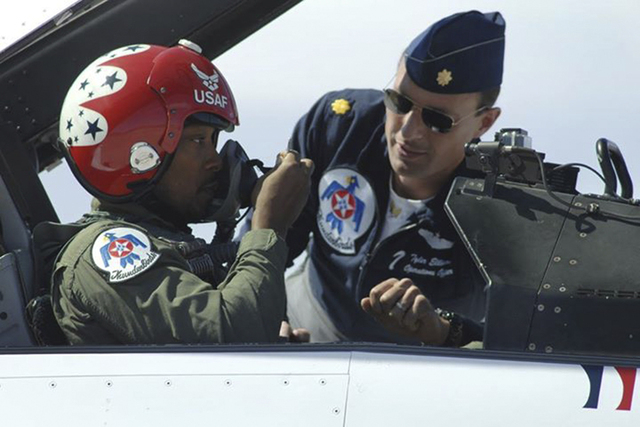 Maj. Tyler Ellison, Thunderbird 7, helps actor Anthony Mackie prepare for an orientation flight at Nellis Air Force Base in March 2014. (Special to View)