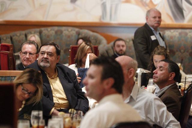 People listen to U.S. Rep. Dina Titus, D-Nev. speak during a Las Vegas Medical Marijuana Association luncheon at Lawry's The Prime Rib restaurant in Las Vegas Wednesday, Aug. 27, 2014. (Erik Verdu ...