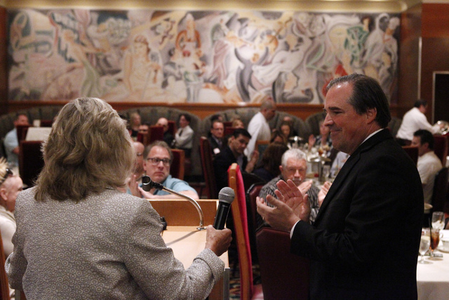 U.S. Rep. Dina Titus, D-Nev., left, hands the microphone to John Laub, president of the nonprofit advocacy group Las Vegas Medical Marijuana Association, as she finishes speaking during an associa ...