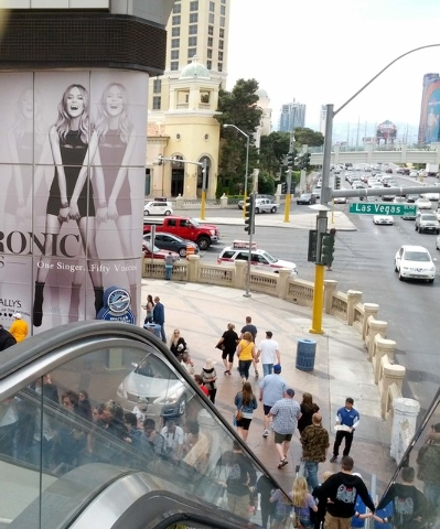 People use an escalator at the southeast corner of Flamingo Road and Las Vegas Boulevard South on March 27, 2014. Las Vegas had the weakest monthly percentage increase of visitors of the year in J ...