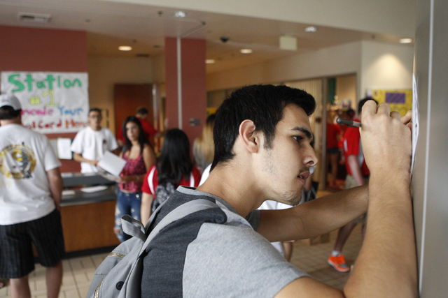 Jake Demello, 18, checks in at the Dayton Complex residence halls during move in day at UNLV in Las Vegas Wednesday, Aug. 20, 2014. (Erik Verduzco/Las Vegas Review-Journal)